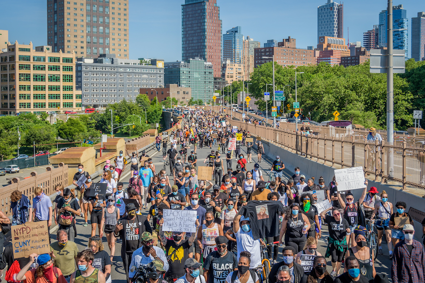 Protesters flood the Brooklyn Bridge on Tuesday. (Photo credit: Getty Images)