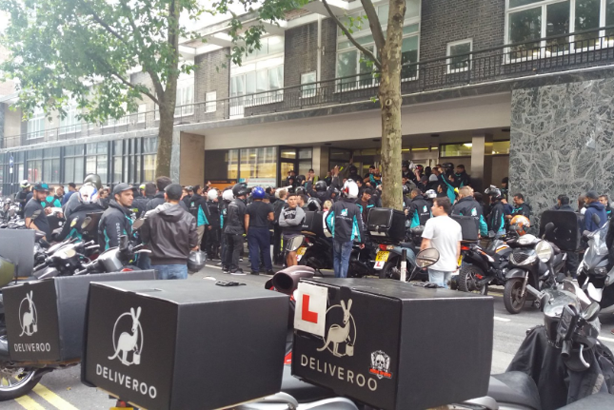 Deliveroo drivers protest outside the firm's offices (Credit: Melissa Bovia via Twitter)