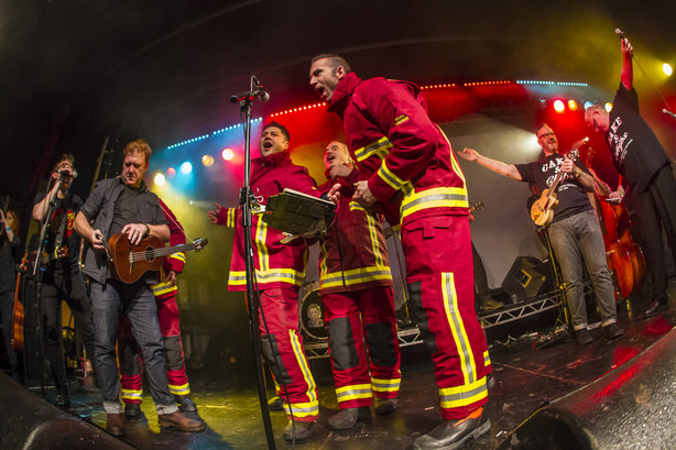 The band with members of Red Watch performing 'Chip Pan' last December