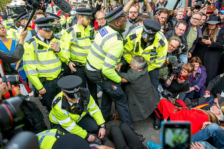 Police getting to grips with Jonathan Bartley, co-leader of The Green Party, during an XR protest in London last October  (Pic credit: Ollie Millington/Getty Images)