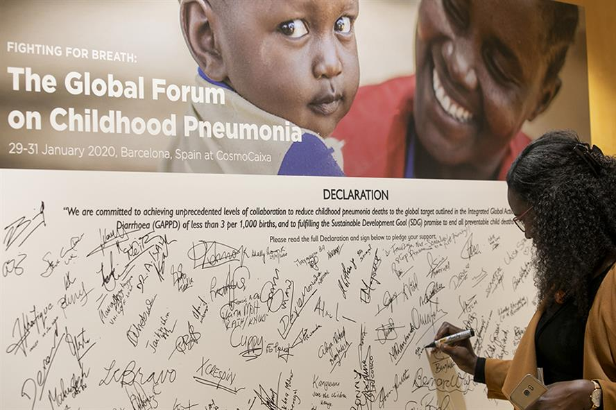 A delegate signs the Global Forum action statement committing to specific, measurable actions governments and international development agencies will pursue to end preventable child pneumonia deaths by 2030