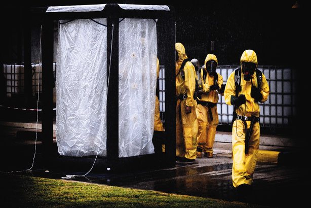 Workers wearing hazmat suits, in one of the images in the new guidance produced by the CIPR and CPNI