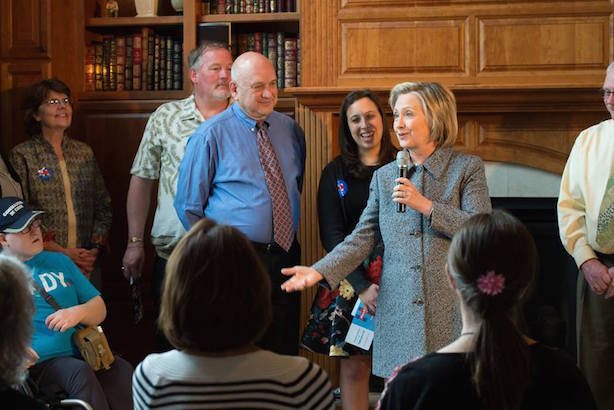 Clinton chats with supporters in Iowa. (Image via Clinton's Facebook page).