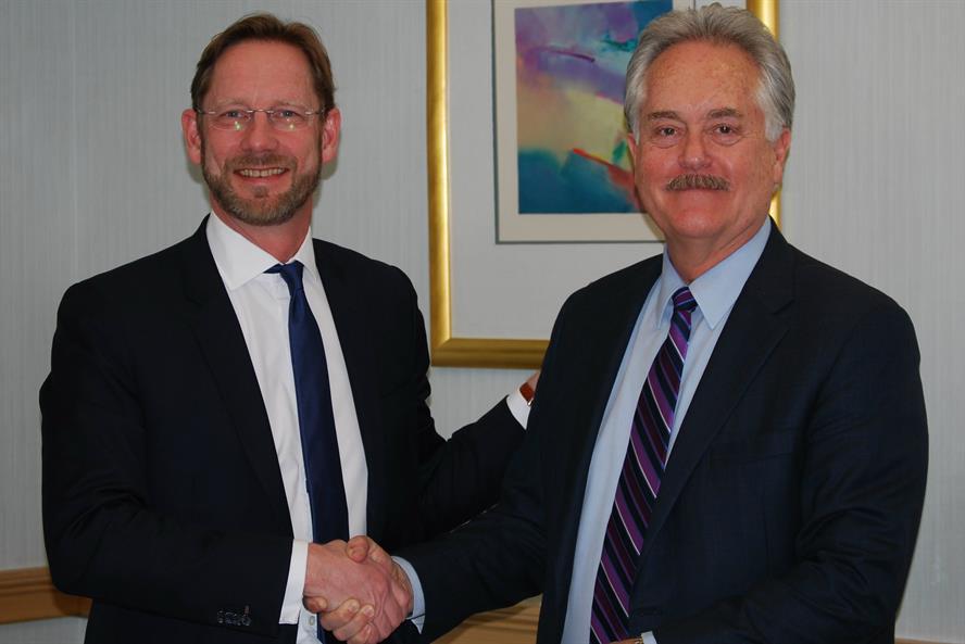 Deal: Interel CEO Fredrik Lofthagen (left) with his AMG counterpart J. Bruce Wardle