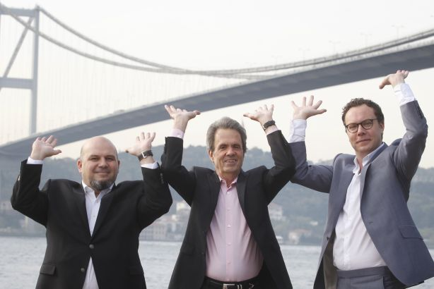 Bridging the world: (l-r) Berkan, Cook and Neale