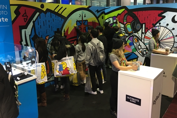 CES attendees add to Logitech's mural.