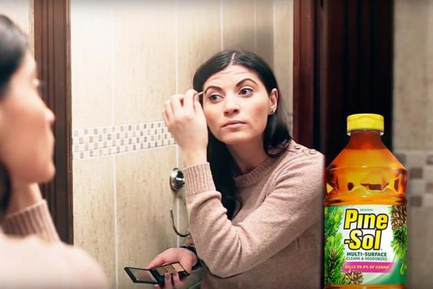 """Pine-Sol is showing off all the things it's good for, as well as cleaning floors. (Image via the Pine-Sol YouTube video """"Date."""")"""