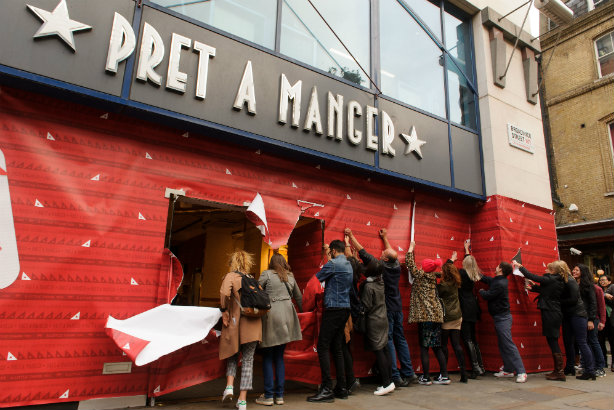 Pret: Customers unwrap a central London store on Monday to get to its festive food