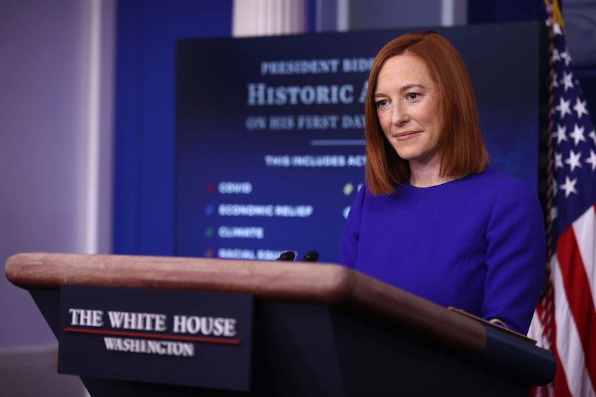 Jen Psaki briefs the press on the first day of the Biden administration. (Photo credit: Getty Images).