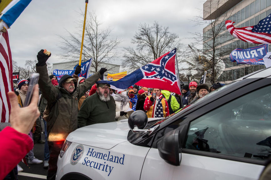 Rioters outside the Capitol building carried Confederate flags. (Source: Getty Images).