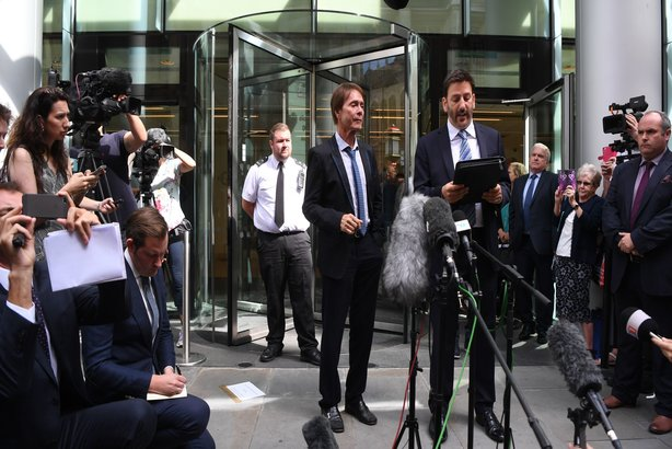 Sir Cliff Richard and his solicitor, Gideon Benaim, outside the Rolls Building of the High Court in London after the singer won his court case against the BBC