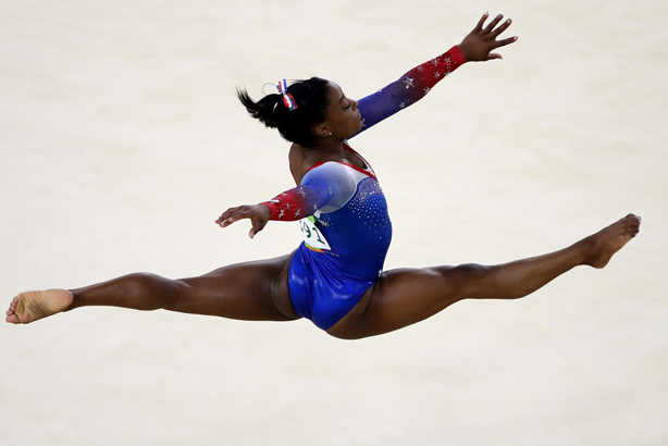 US gymnast Simone Biles will be flying high with more sponsorship deals after her Rio success Credit: Julian Finney