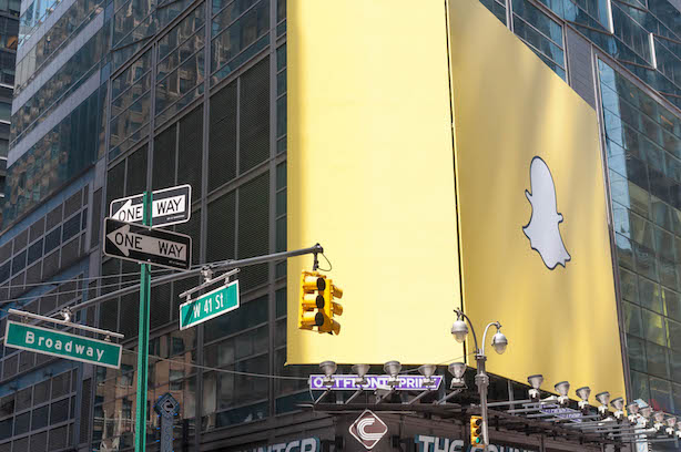 (Image via Wikimedia Commons, by Marco Verch - Snapchat-Werbung auf Times Square New York, CC BY 2.0)