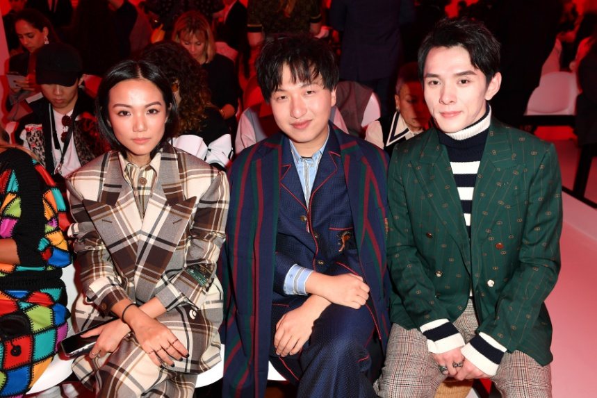 "Handbag influencer Tao Liang (middle) aka Mr Bags can generate ""half a million dollars in sales in a couple of minutes"" for brands"