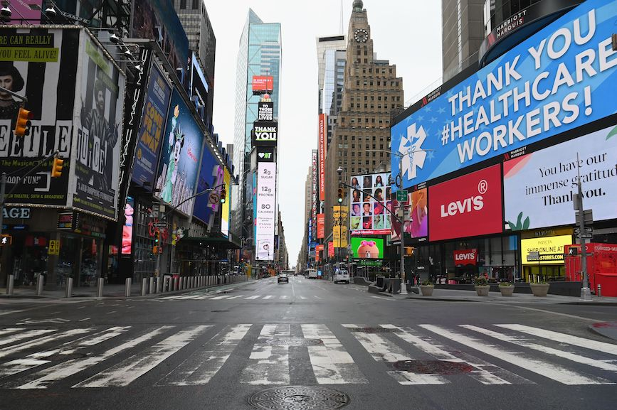 Times Square is a ghost town as New Yorkers shelter in place to help stop the spread of COVID-19. (Photo credit: Getty Images)