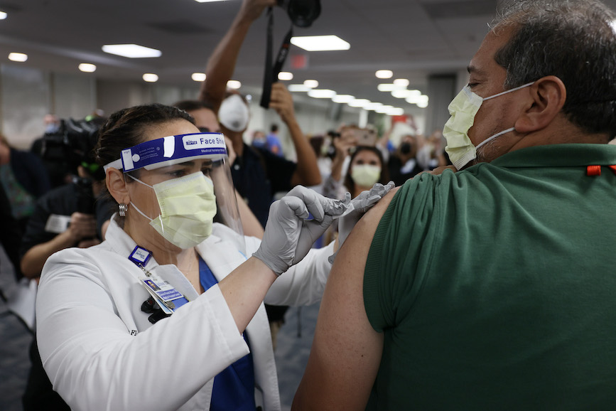 A healthcare worker in Miami gets vaccinated for COVID-19 this week. (Photo credit: Getty Images)