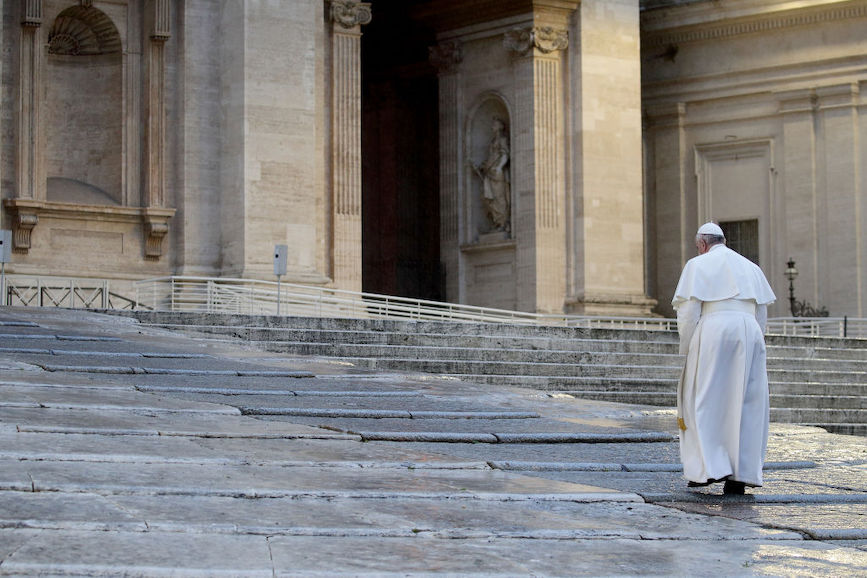 Pope Francis arrives to deliver a prayer to an empty St. Peter's Square (Photo credit: Getty Images)