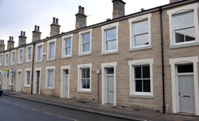 Thirteen terraced properties were remodelled into seven new homes. Pic by Mike Poloway/UNP