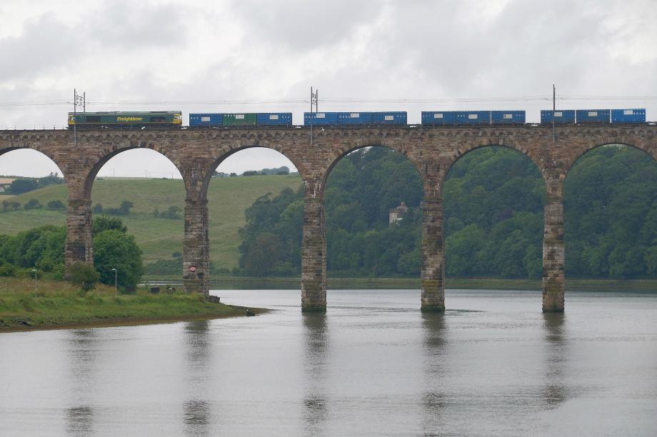 A freight train crosses the Royal Border Bridge in Northumberland on the East Coast Main Line. Image credit: Matt Buck / Flickr