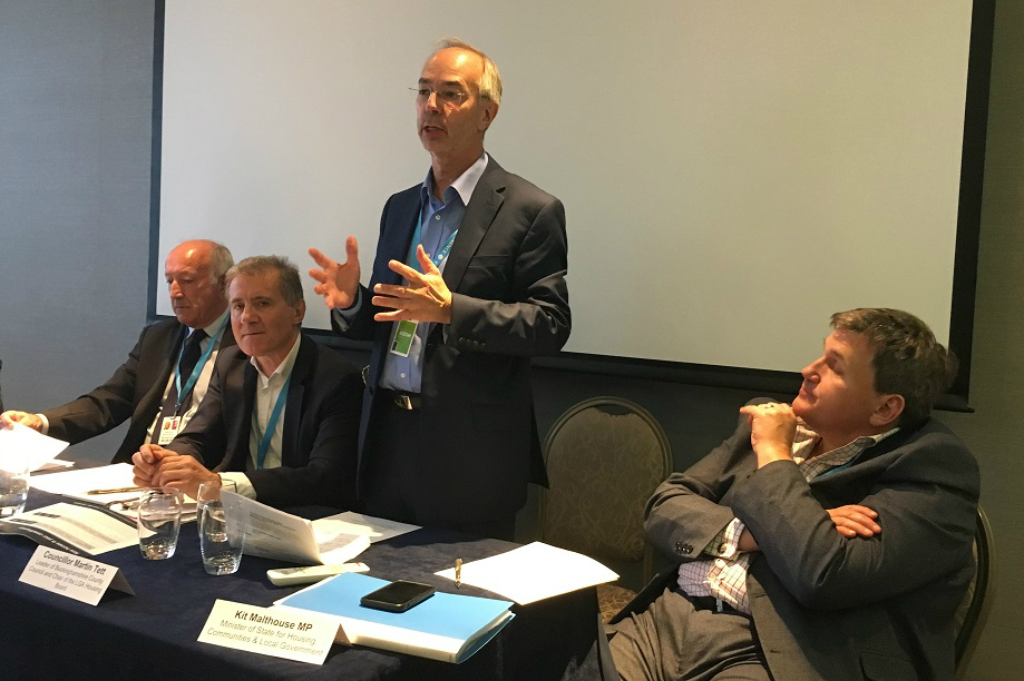 Councillor Martin Tett (standing), chair of the LGA environment, economy, housing  and transport board, speaking at the TCPA fringe event
