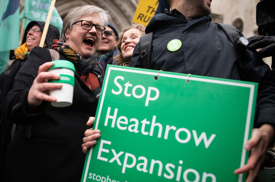 Green campaigners celebrate the Heathrow decision outside the Royal Courts of Justice last week (pic: Getty)